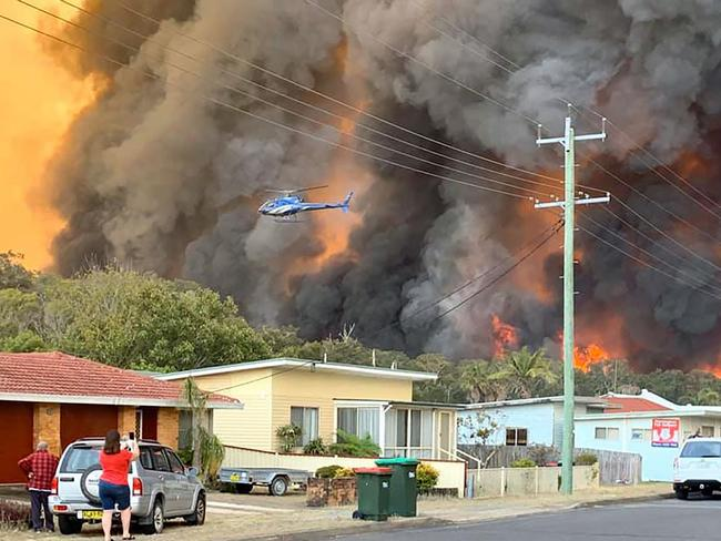 A residential area is threatened by flames northeast of Sydney. Picture: Kelly-ann Oosterbeek