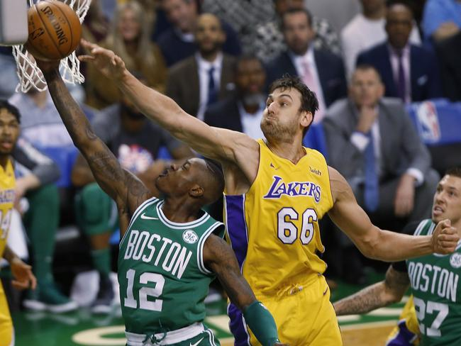 Celtics' Terry Rozier vs Andrew Bogut during the first quarter.