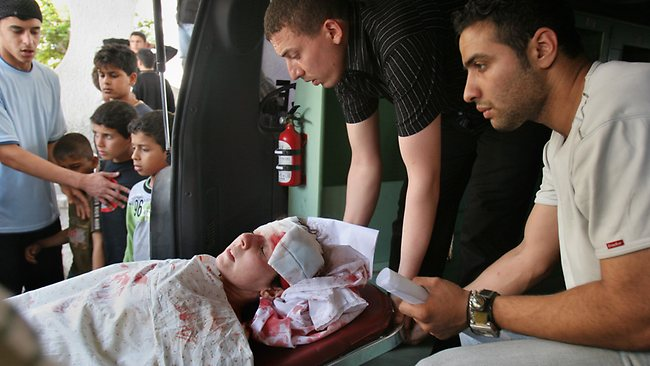 A wounded woman is wheeled to the Shifa hospital in Gaza City, after an Israeli air strike on May 17, 2007. Picture: AP /Adel Hana