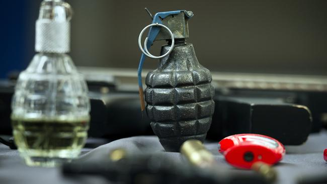 An inert hand grenade with other banned items. Picture: AP/Cliff Owen