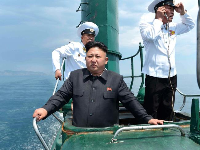 """At the helm ... North Korean dictator Kim Jong Un during a recent publicity shoot on a refurbished """"Romeo"""" class submarine. Source: DPRK"""