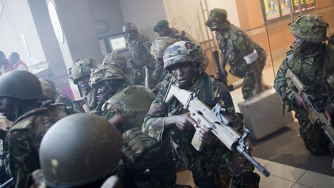 FILE Armed police leave after entering the Westgate Mall after gunmen threw grenades and opened fire Saturday.