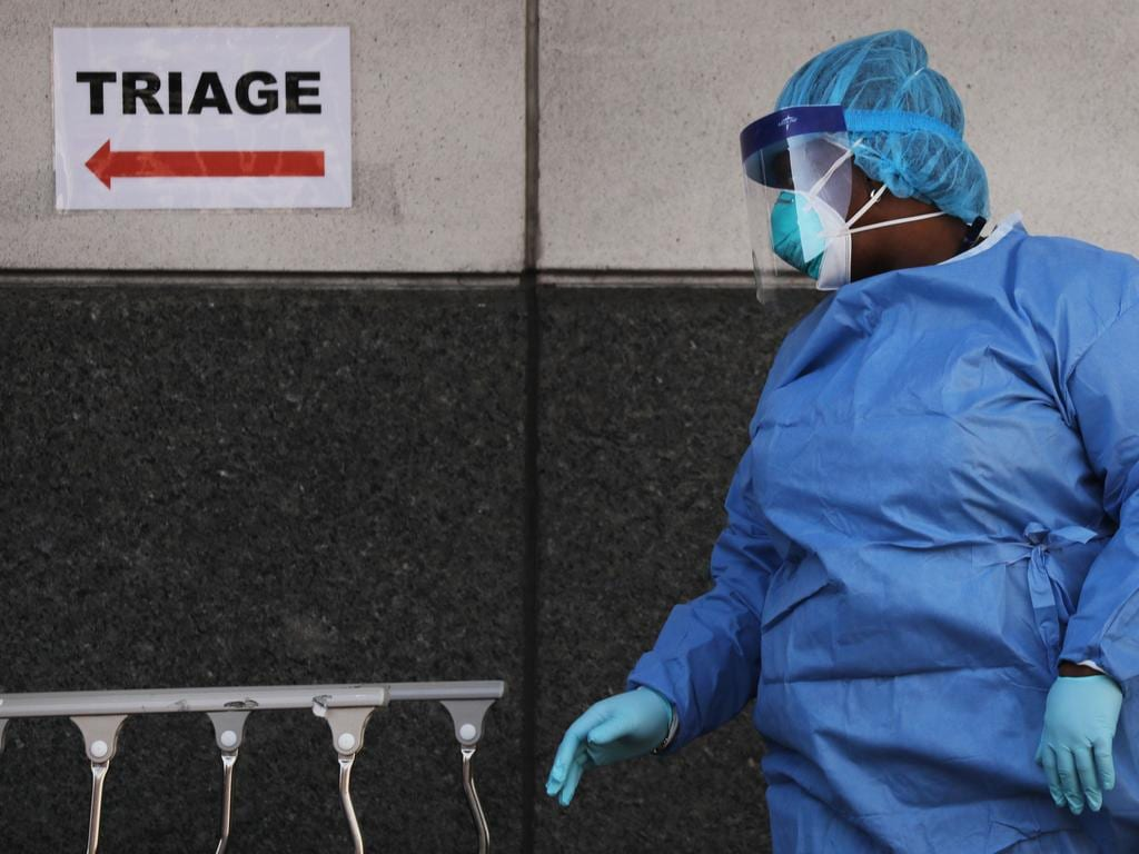 A medical worker walks outside of a special coronavirus intake area at Maimonides Medical Center in the Borough Park neighbourhood of the Brooklyn borough of New York City. Picture: Getty Images/AFP