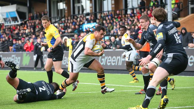Former Wallaby George Smith on his way to the try-line against Newcastle.