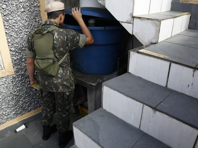Army soldiers check for Aedes aegypti mosquito larvae during a clean-up operation against the insect, which transmits the Zika virus, in Sao Paulo, Brazil. Picture: AFP