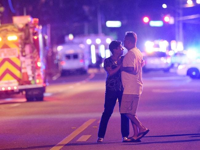 Family members wait for word from police after arriving down the street from a shooting involving multiple fatalities at Pulse nightclub in Orlando, Florida. Picture: Phelan M Ebenhack