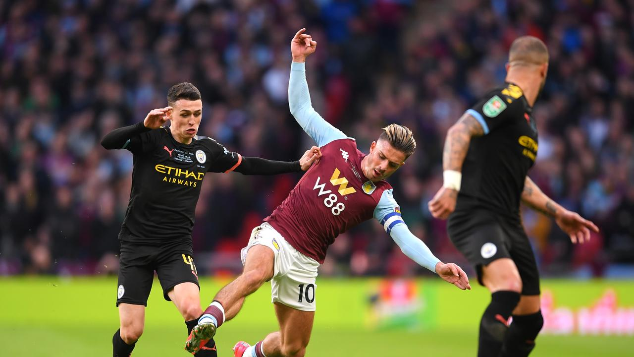 Jack Grealish of Aston Villa is tackled by Phil Foden of Manchester City during the Carabao Cup Final between Aston Villa and Manchester City at Wembley Stadium on March 01, 2020 in London, England. (Photo by Laurence Griffiths/Getty Images)