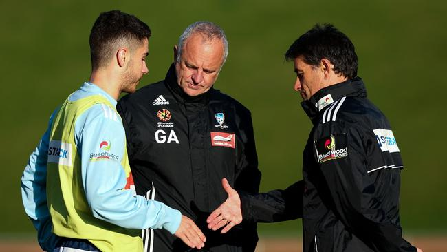 WELLINGTON, NEW ZEALAND - JULY 24: Chris Naumoff shakes hands with assistant coach Rado Vidosic while coach Graham Arnold looks on during a Sydney FC training session at Newtown Park on July 24, 2014 in Wellington, New Zealand. (Photo by Hagen Hopkins/Getty Images)