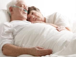 Loving wife hugging sick husband
