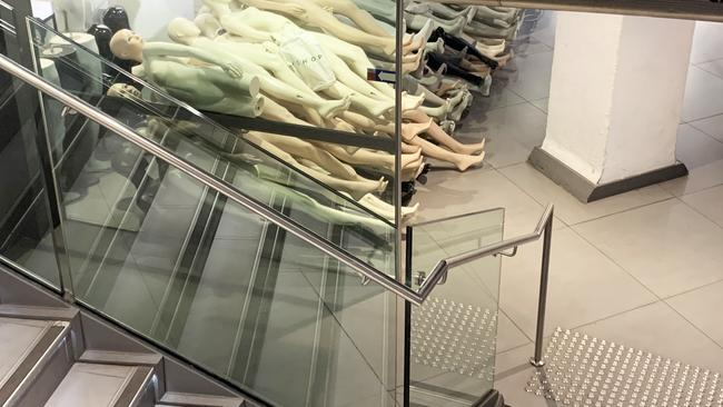 No longer needed mannequins lay piled up in a corner of the store. Picture: news.com.au/Benedict Brook.