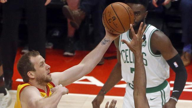 Utah Jazz forward Joe Ingles (2) goes to the basket as Boston Celtics  center Al Horford (42) defends in the first half during an NBA basketball  game Friday ... dd425c685d54