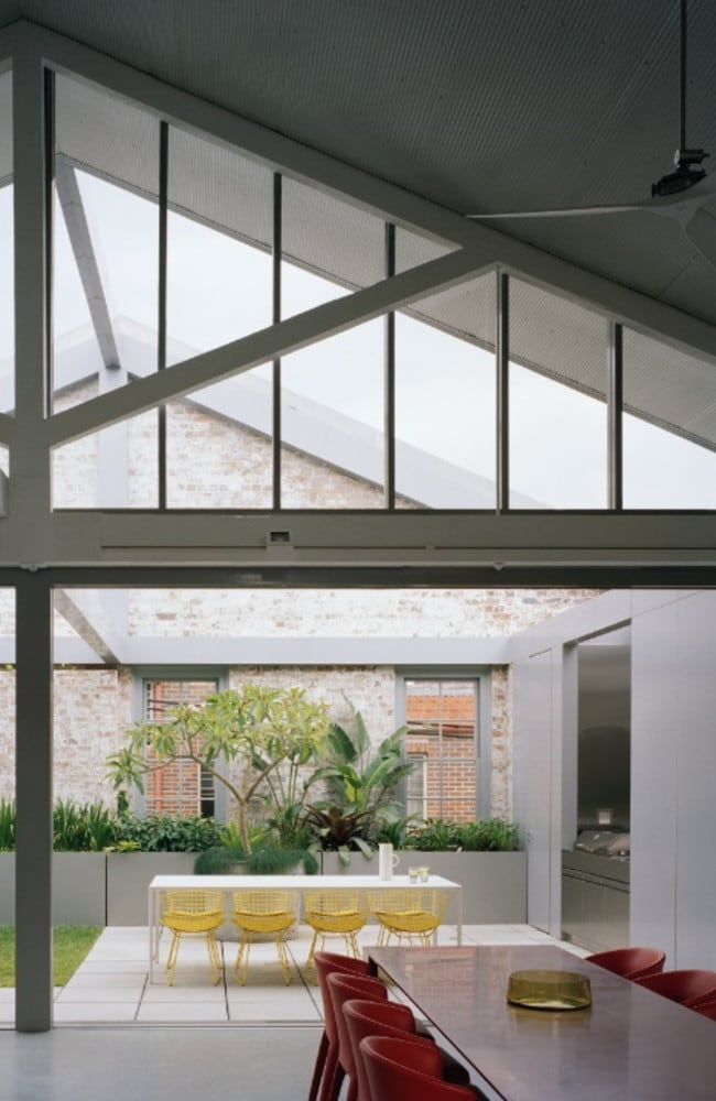 Two-storey Redfern Warehouse in Sydney by Ian Moore has been converted to a family home, with an internal courtyard and terrace formed by removal of sections of roof. Picture: Rory Gardiner