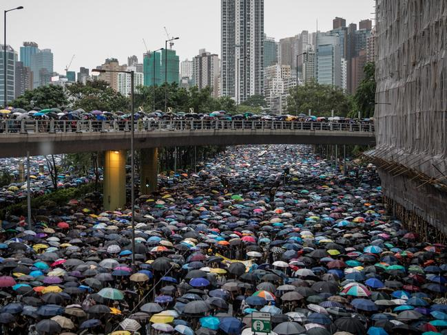 More than a million anti-government protesters march on a street after leaving a rally in Victoria Park. Picture: Chris McGrath/Getty Images