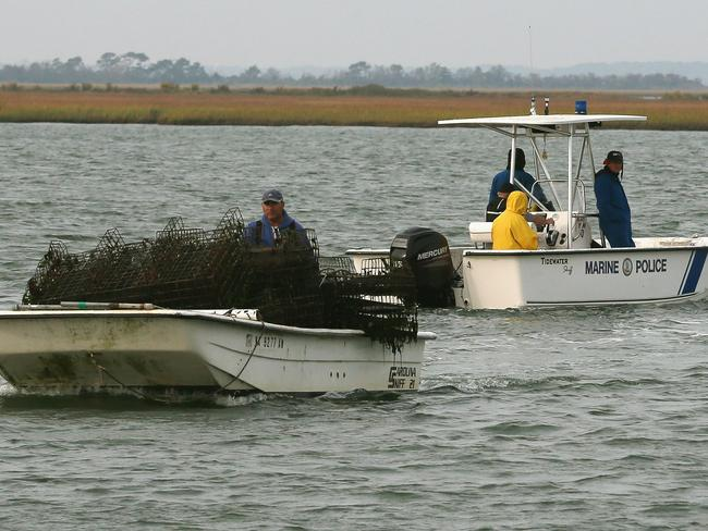 Potential hazards ... Fishermen and police in the waters surrounding the flight facility.