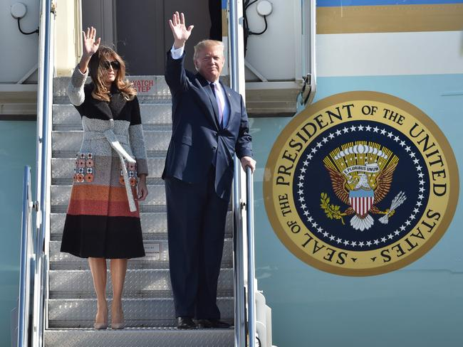 US President Donald Trump and his wife Melania arrive at Yokota Air Base in Tokyo on November 5. Picture: Kazuhiro Nogi/AFP