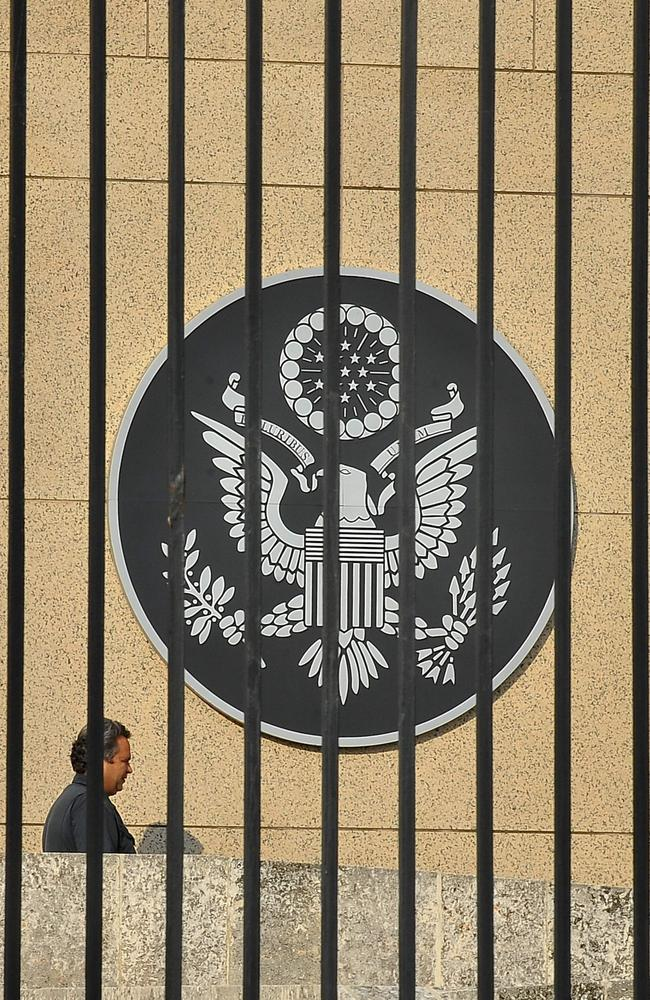 This file photo taken on December 17, 2015 shows a man walking by the US Embassy in Havana. Picture: Yamil Lage