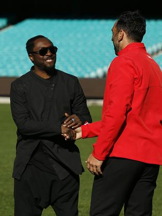 Best on ground ... will.i.am with Swans star Adam Goodes. Picture: Tim Hunter