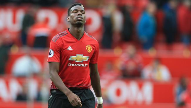 Manchester United's French midfielder Paul Pogba reacts as he leaves the pitch