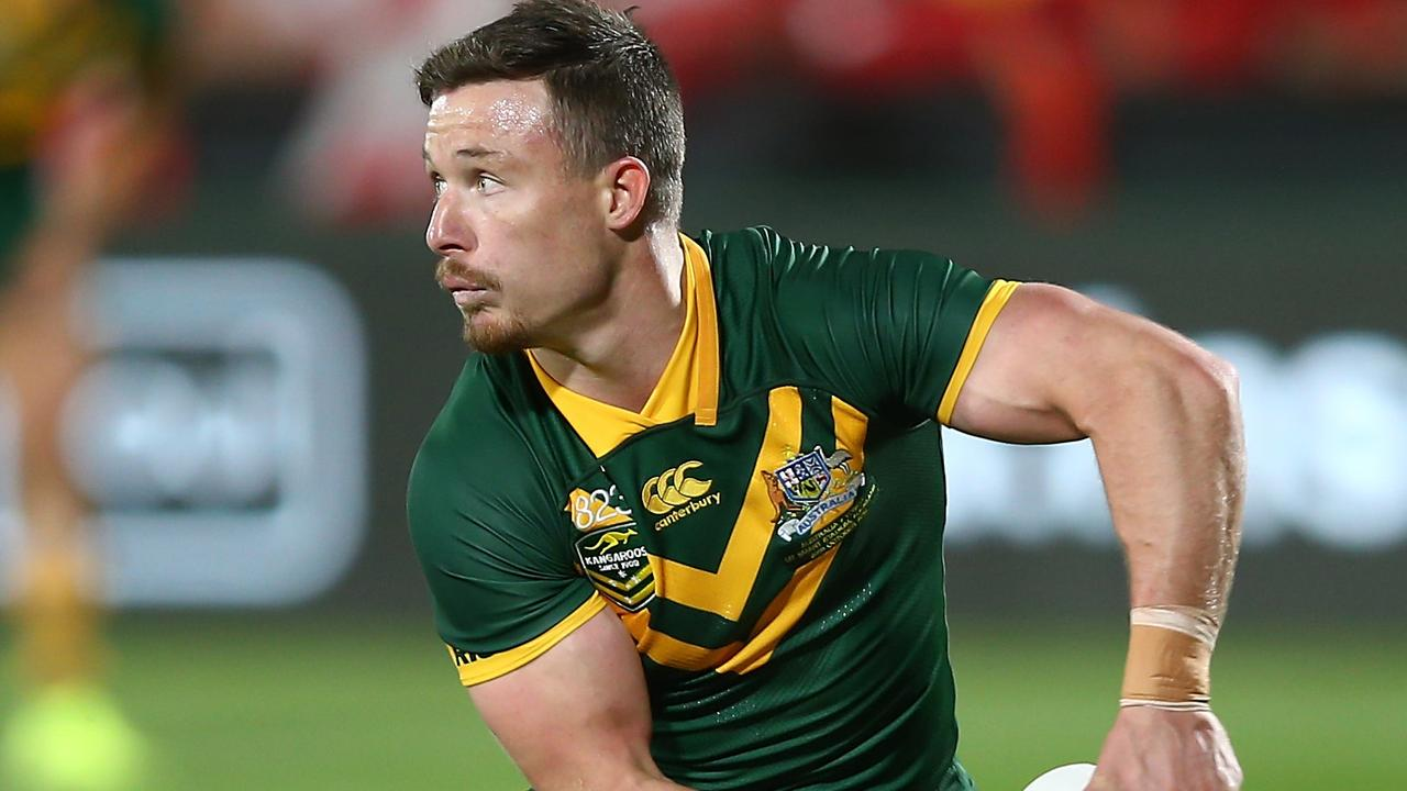 Damien Cook in action for the Kangaroos against Tonga.