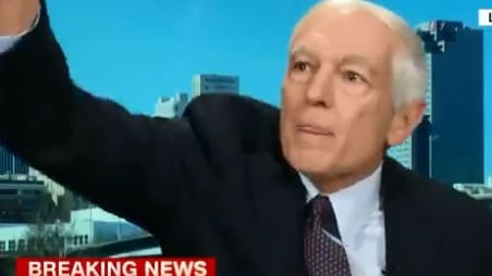 General Wesley Clark flung his mobile phone across the room during a live interview. Picture: Twitter/@brianstelter