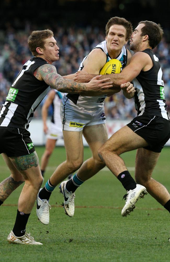 Magpies Dayne Beams and Steele Sidebottom close in on Power midfielder Jared Polec. Picture: George Salpigtidis