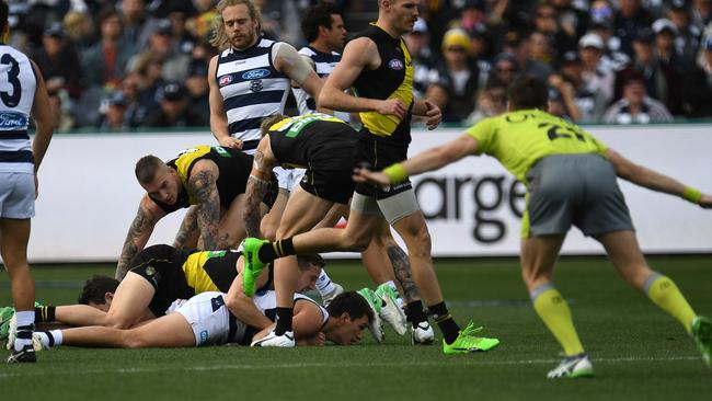 Richmond is awarded a holding the ball free kick, but the Cats won 11 more frees for the game. Picture: AAP