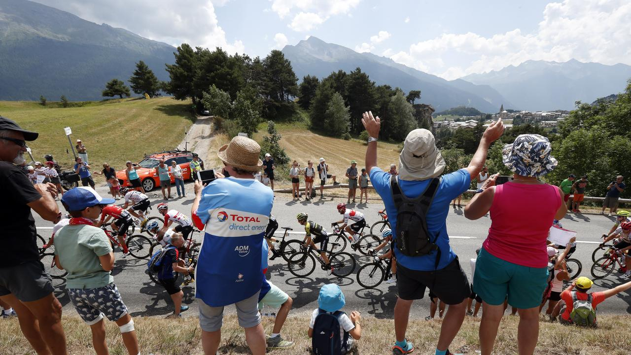 In this file photo taken on July 26, 2019 spectators along the road applaud the riders during the nineteenth stage of the Tour de France cycling race between Saint Jean De Maurienne and Tignes.