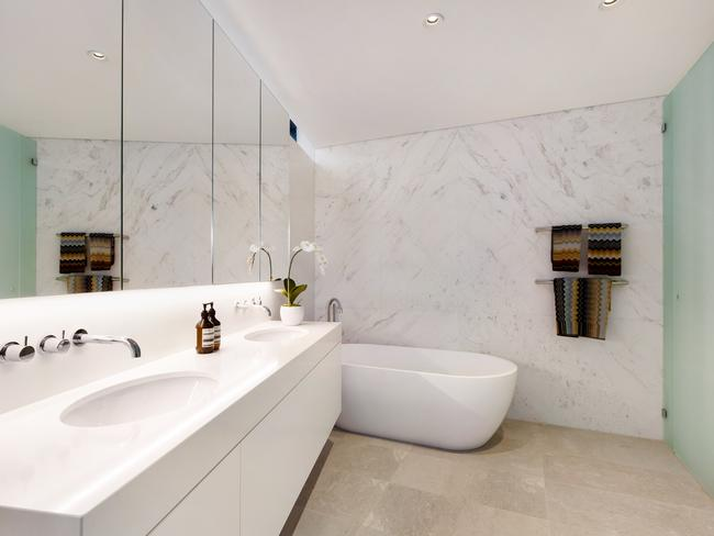 The bathrooms are simple and classy and the master suite has a freestanding oval bath.