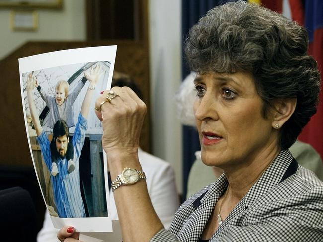 Judy Cavnar, a cousin of executed Texas prison inmate Cameron Todd Willingham, displays a picture of him during a news conference in 2006.