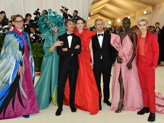Troye Sivan, Adut Akech, Adam Shulman, Anne Hathaway, Pierpaolo Piccioli, Frances McDormand and Hamish Bowles on the red carpet. Picture: AFP