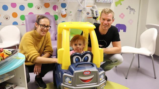 Eleanor Oakley from Tasmania is between hospital visits with parents Jacqui and Rob Oakley.