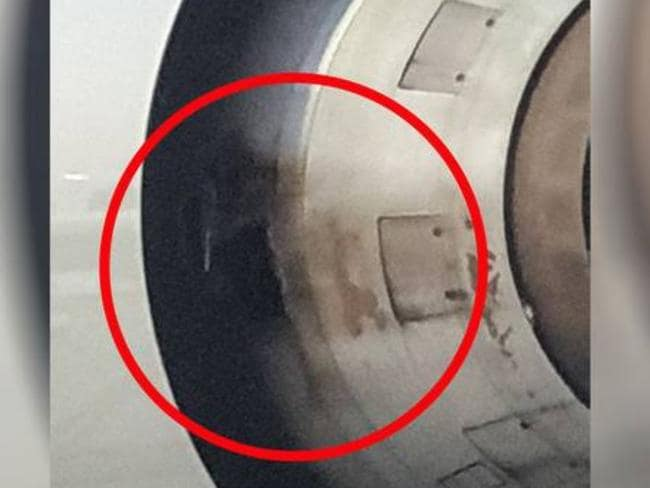 Passenger Andy Riley said there was a 40cm by 40cm hole in the side of the port side engine. Picture: Andy Riley