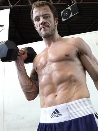 Jarrod Fletcher gets a workout at the Fortitude Valley gym.