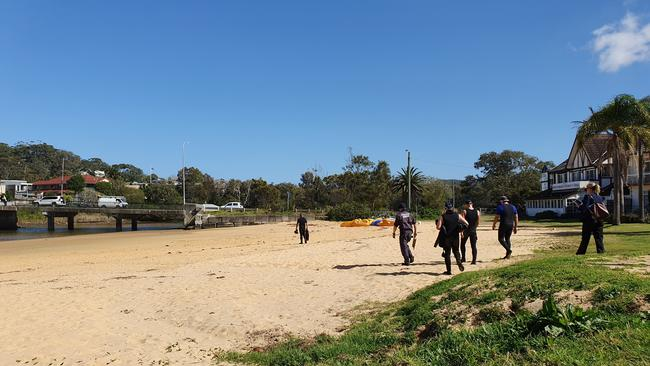 Police search Terrigal Lagoon after the discovery of Ms Howard's body. Picture: Fiona Killman
