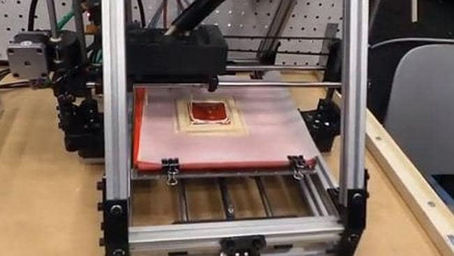 The prototype 3D printing machine making 'pizza'.