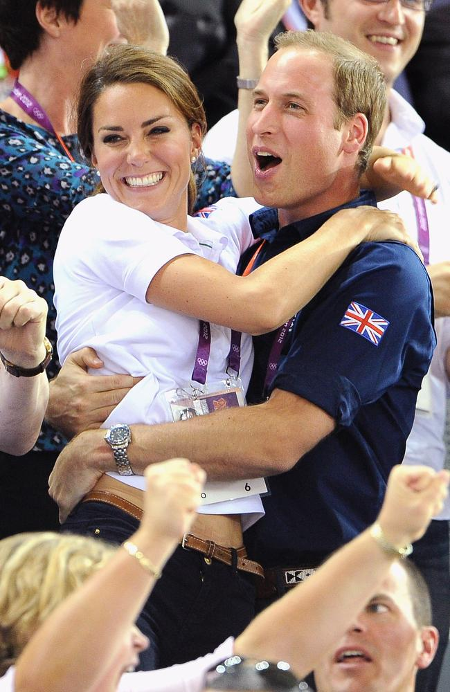 Kate and William show some rare PDA at the London 2012 Olympic Games in 2012. Picture: Pascal Le Segretain/Getty Images