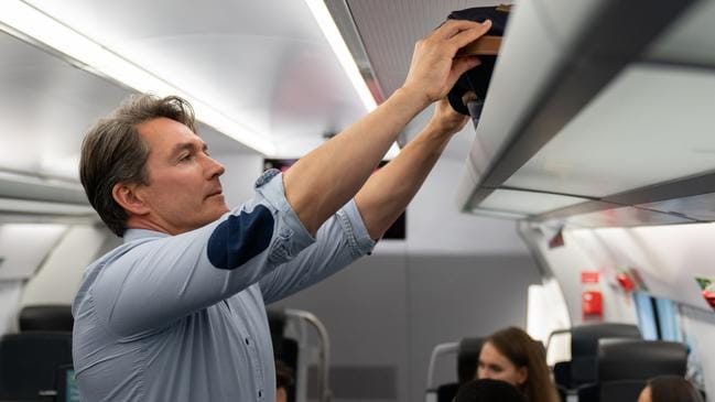 Get items out of the overhead bin after takeoff.