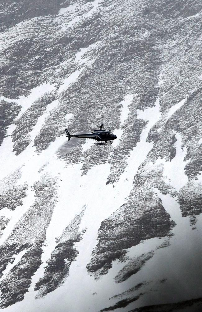 Difficult terrain ... A rescue helicopter flies over the remote mountainside near Seyne-les-Alpes, French Alps. Picture: AP