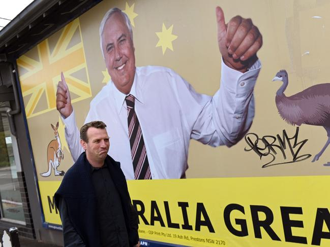 A billboard of United Australia Party leader Clive Palmer in Melbourne. Picture: William West/AFP