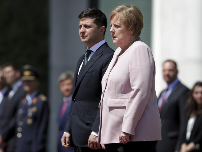 Angela Merkel trembled during a military service in Berlin. Picture: AP