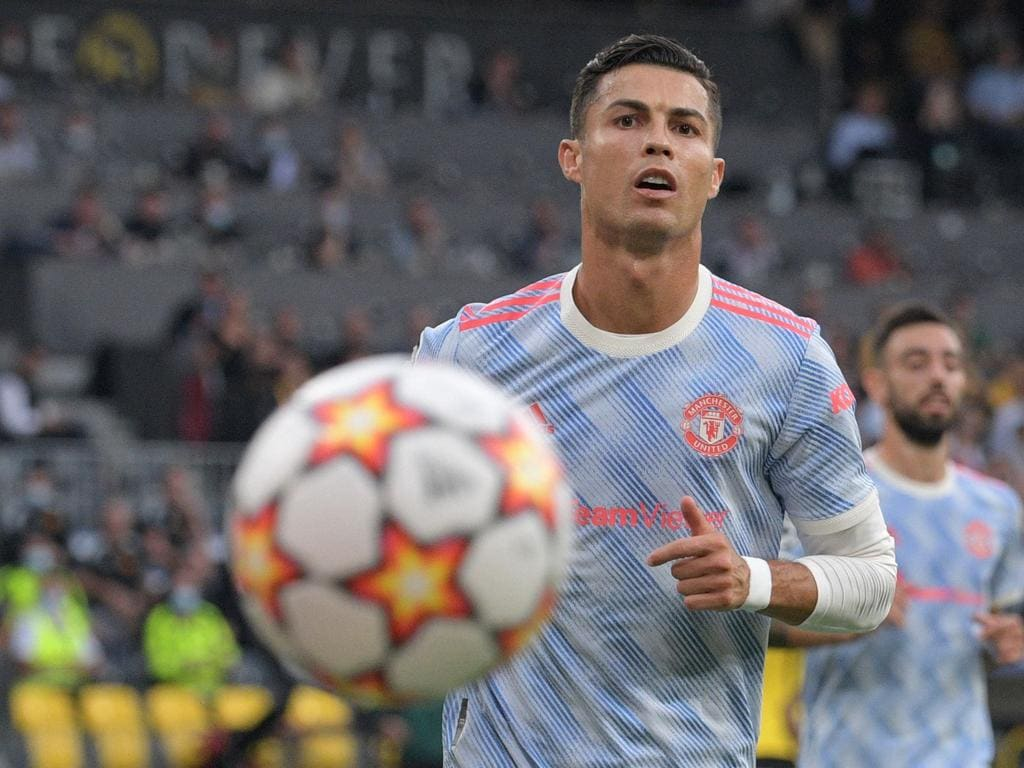 Manchester United's Portuguese striker Cristiano Ronaldo eyes the ball during the UEFA Champions League Group F football match between Young Boys and Manchester United at Wankdorf stadium in Bern, on September 14, 2021. (Photo by SEBASTIEN BOZON / AFP)