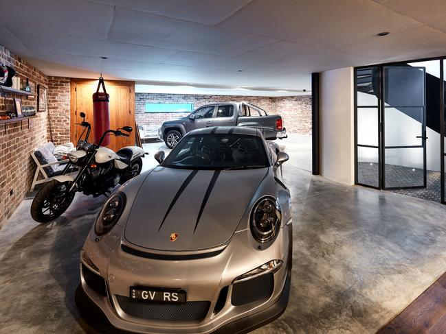 The garage can fit four cars and has a turntable