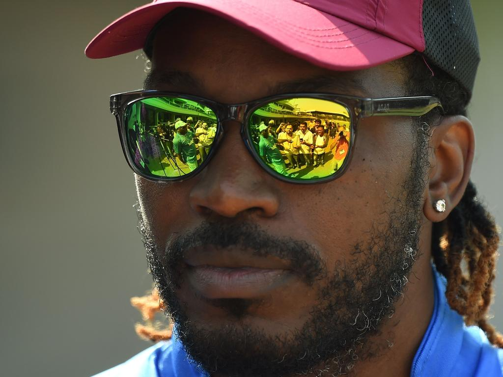 West Indies batsman Chris Gayle meets with journalists before the start of a training session at the Cricket Club of India stadium in Mumbai on March 29, 2016. West Indies plays their World T20 cricket tournament semi-final match against India on March 31 in Mumbai. / AFP PHOTO / PUNIT PARANJPE