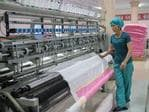 A women operates a machine in the Kim Jong Suk Silk Factory on August 21, 2018 in Pyongyang, North Korea. Picture: Carl Court/Getty Images