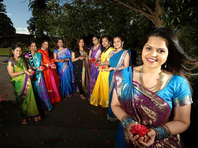 Preparations for this year's Footscray Diwali Festival. From left to right, Rupa, Shubhangi, Suchitra, Sindhi, Palak, Vineela, Divya, Kirti and Kuki in Footscray Park. Picture: Hamish Blair