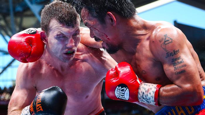 "CORRECTION - Manny Pacquiao (R) of the Philippines fights Jeff Horn (L) of Australia during the World Boxing Organization boat at Suncorp Stadium in Brisbane on July 2, 2017. / AFP PHOTO / Patrick HAMILTON / -- IMAGE RESTRICTED TO EDITORIAL USE - STRICTLY NO COMMERCIAL USE -- / ""The erroneous mention[s] appearing in the metadata of this photo by Patrick HAMILTON has been modified in AFP systems in the following manner: [July 2] instead of [July 1]. Please immediately remove the erroneous mention[s] from all your online services and delete it (them) from your servers. If you have been authorized by AFP to distribute it (them) to third parties, please ensure that the same actions are carried out by them. Failure to promptly comply with these instructions will entail liability on your part for any continued or post notification usage. Therefore we thank you very much for all your attention and prompt action. We are sorry for the inconvenience this notification may cause and remain at your disposal for any further information you may require."""