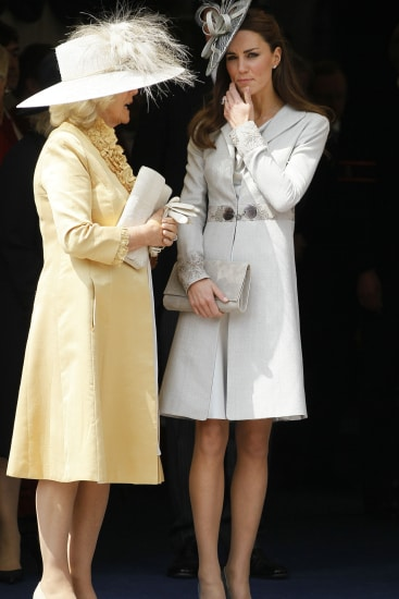 WINDSOR, ENGLAND - JUNE 13: Camilla, Duchess of Cornwall (L) and Catherine, Duchess of Cambridge watch the Garter Service pass by on June 13, 2011 in Windsor, England. The Order of the Garter is the senior and oldest British Order of Chivalry, founded by Edward III in 1348. Membership in the order is limited to the sovereign, the Prince of Wales, and no more than twenty-four members. (Photo by Kirsty Wigglesworth/WPA Pool/ Getty Imagesl)