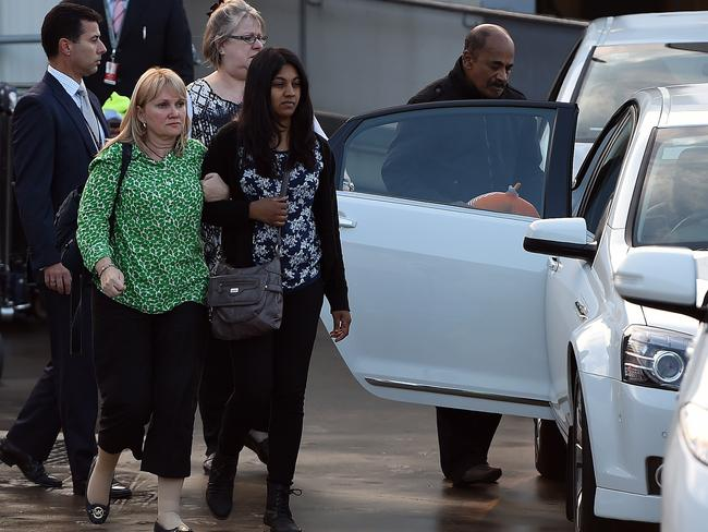 Family toll ... Brintha Sukumaran (C), sister of executed Australian drug convict Myuran Sukumaran, leaves with family members following the arrival her brother's remains at the Sydney International Airport on May 2. AFP PHOTO / SAEED KHAN
