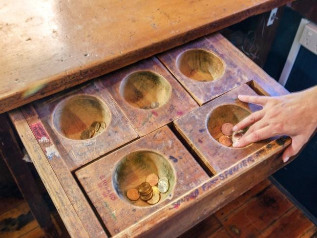 An original coin drawer.