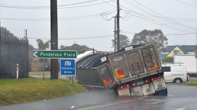 A truck stuck on a collapsed corner of road at Dromana. Picture: Adam Richmond